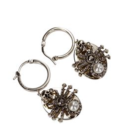 white old spide earrings