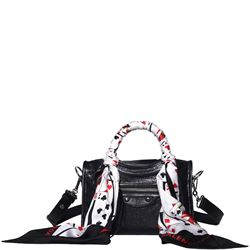 black leather bag with scarf