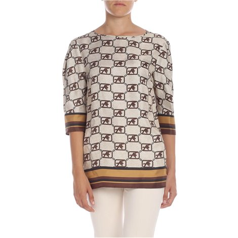 black and shades of brown<br/>contrasting monogram motif<br/>button closure on the back<br/>loose fit