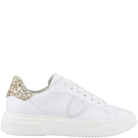 white and golden patched sneakers