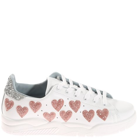 white sneakers with pink hearts